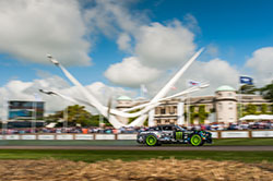 No Downton Abbey here. JR powers past the stately Goodwood Manor House and the massive display of this year's event sponsor