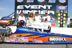 Brodix in the winner's circle with K&N products in their dragster.