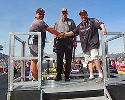 David Mangrum of Houma, Louisiana and Frank Savarese shake hands before their drivers Jason Line and Erica Enders-Stevens face off