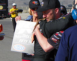 Frank Savarese and Erica Ender-Stevens traded a hug as she stepped out of the car following her second NHRA K&N Horsepower Challenge victory