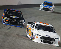Austin Hill overtakes William Byron at the UNOH 100 NASCAR K&N Pro Series East race at Richmond