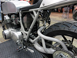 Custom single sided swing arm on Gasser Customs motorcycle