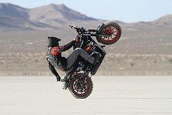 Carpenter living up to the name One Wheel Revolution in the dust of El Mirage.