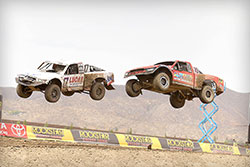 Greg Adler and Carl Renezeder jumping over 150 ft while battling for the lead