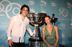 Dario Franchitti and wife Ashly Judd flank the 2009 IndyCar Series Championship Cup