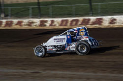 Sprint car driver Jarett Adretti zooms by at the USAC race