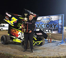 Jake Andreotti proudly poses with his trophy and the number 7P K&N Filters Micro Sprint Car in victory circle at Plaza Park Raceway in Visalia, California