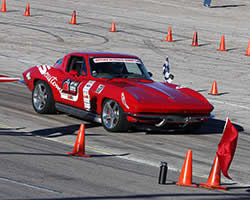 Jane Thurmond and her 1964 Chevrolet Corvette nicknamed Scarlett