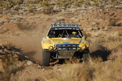 Macrae and co-pilot Brian Busby continued to pad their lead throughout the race finishing with a 47 minute lead over the second place Class 8 truck.