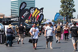 Fans walking by K&N booth at Auto Enthusiast Day