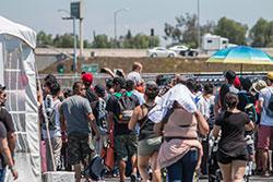 Fans walking around Auto Enthusiast Day in Anaheim, Ca