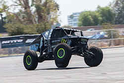 Cody Curry on three wheels at Auto Enthusiast Day