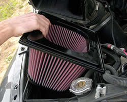 K&N air filter being installed into vehicle