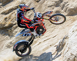 Team Peterson uses a KTM 950 engine in their hill climb bike proving the objective at KTM for its first twin-cylinder engine to be light, compact, and versatile was successful