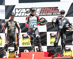 Just four days after knee surgery K&N sponsored XR1200 racer Kyle Wyman stands on the AMA Pro Vance & Hines Harley-Davidson Series podium in third behind Steve Rapp and Danny Eslick