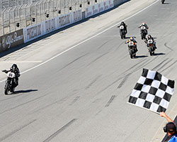 Wyman lost some ground on the Vance & Hines Harley-Davidson race leaders Steve Rapp and Danny Eslick but crossed the finish line at Laguna Seca a good distance in front of the pack