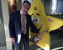Bobby Likis with the Capstone Adaptive Learning & Therapy Centers StarFest telethon mascot Sparky