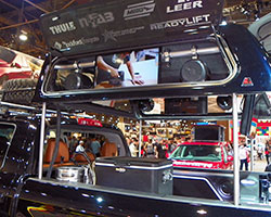 Fully motorized Leer 100XR camper shell with wind doors and heavy commercial lamination