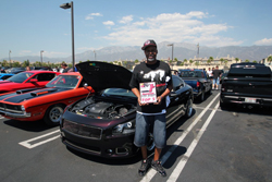 Sean Sheppard showing off his win for his 2010 Nissan Maxima