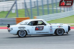 Jake Rozelle driving his 1969 Chevrolet Camaro at Circuit of the Americas