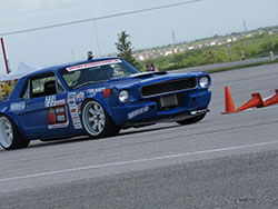 Mike Maier driving his 1966 Ford Mustang at Circuit of the Americas