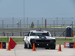 Jake Rozelle driving his 1969 Camaro in te speed stop challenge