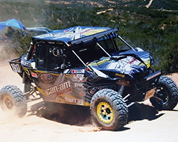 Derek Murray and Bill Kugel sailed through race mile 320 passing two other UTV racers at a pit stop