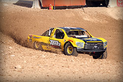 Throwing some dirt with the Tonka Truck.