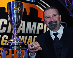 2014 NASCAR K&N Pro Series West champion Greg Pursley shows off his new championship ring