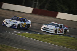 Cale Conley leads Brett Moffitt at NASCAR K&N Pro Series East race Jegs 150 at Iowa Speedway.