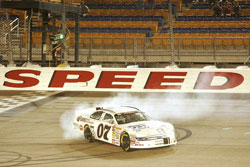 Corey LaJoie does a burnout to celebrate his Pork Be Inspired 150 win at Iowa Speedway.