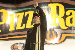 An excited Corey LaJoie celebrates in victory lane after NASCAR K&N Pro Series Race at Iowa Speedway.