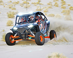The 2014 Polaris RZR XP 4 1000 boasts 107 horsepower and seating for four sand dune fanatics