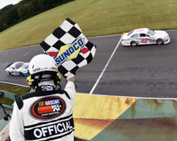 Sergio Pena and Kaz Grala at the finish line of the NASCAR K&N Pro Series East Biscuitville 125.