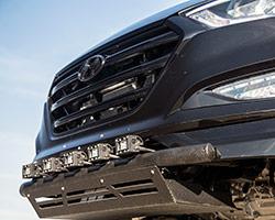 A custom LED light bar setup from Bulldog LED Lighting and custom off road bumpers help the Rockstar Performance Garage 2016 Hyundai Tucson 1.6L turbo shrug off impacts