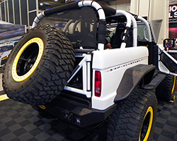 """ATX 20"""" Slab beadlock wheels wrapped in Mickey Thompson 38x15.5R20 Baja MTZ mud terrain tires provide traction, while Wilwood brakes provide friction for the 1973 Ford Bronco"""