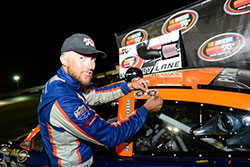 Ryan Partridge adding sticker after winning NASCAR K&N Pro Series West race at Tucson Speedway in Arizona