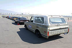 Vehicles waiting to compete on the road course at Auto Club Speedway in Fontana, California