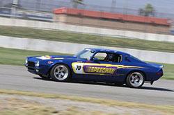 Al Unser Jr driving 1970 Speedway Camaro