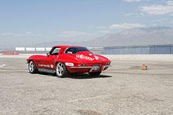 Jane Thurmond driving her 1964 Chevrolet Corvette