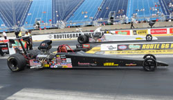 Samantha Kenny drives the black dragster in the NHRA Super Comp class