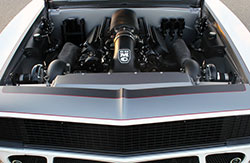 Hidden under the carbon fiber heat extractor hood of this 1967 Chevy Camaro named Snowblind is a Turnkey Engine Supply Chevy LS3 engine with twin turbochargers & intercoolers