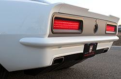 A custom fabricated rear valance, custom integrated rear spoiler, and custom built rear bumper tidy up the backside of this 1967 Chevy Camaro built by EBMC and named Snowblind
