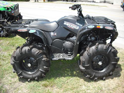 Tejas Motorsports custom Yamaha Grizzly ATV with large mud tires and a K&N air filter.