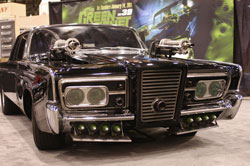 Imagine staring down these twin Gatling type hood guns at this 1965 Chrysler Imperial in your rearview mirror.