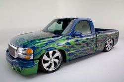 Chris' Blue Custom 2003 GMC Sierra SLE Truck