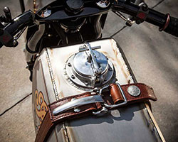 The Track Chief's gas tank was handmade from titanium, capped off with a custom gas cap, stainless steel tank strap buckles, and a leather tank strap complete with Indian Head Nickel