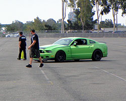 Vaughn Gittin Jr was busy setting up and testing the drift course in his Ford Mustang RTR street car before the Auto Enthusiast Day presented by Nitto Tire was officially underway
