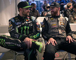 Vaughn Gittin Jr, in the Monster Energy driving suit, sits next to fellow American drifter, 2009 Formula Drift Champion, and newly crowned 2014 Formula Drift champion, Chris Forsberg