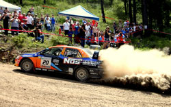 Comrie-Picard and co-driver Jeremy Wimpey, driving in their NOS Energy Mitsubishi Evolution